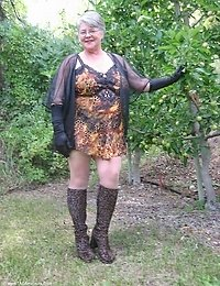 Mature Girdlegoddess in the orchard wearing her sexy leopard print outfit Look at my hairy pussy while Im wearing leopard boots